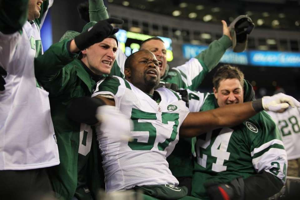Bart Scott celebrates the Jets win over the