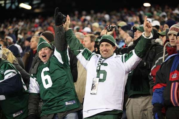 Jets fans celebrate the Jets win over the