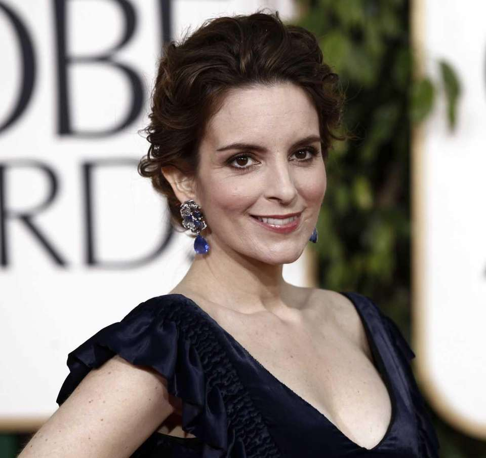 Tina Fey arrives for the Golden Globe Awards