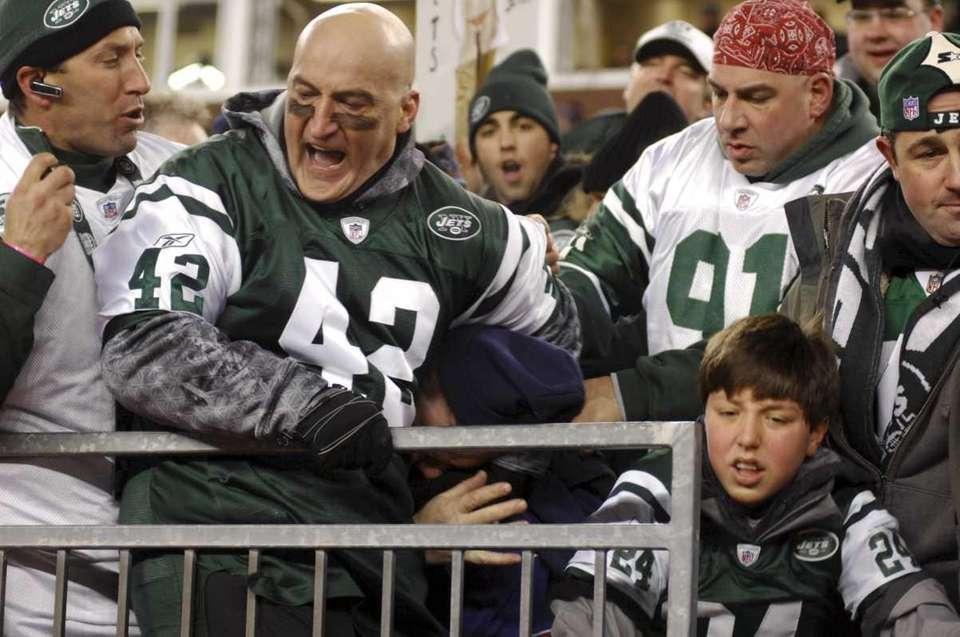 Fireman Ed scuffles with someone at the game.