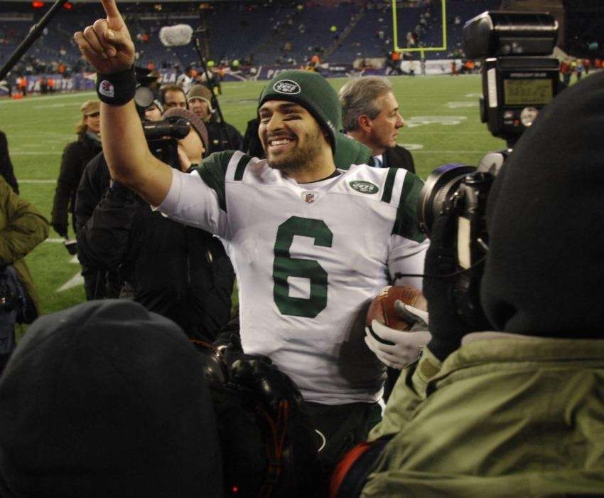 Mark Sanchez celebrates on the field after the