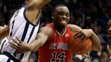 St. John's Mustapha Heron goes to the basket
