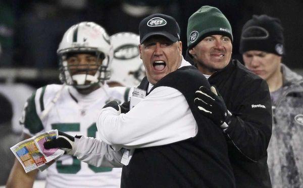 Jets coach Rex Ryan, center, reacts near the