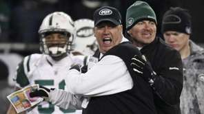 Jets coach Rex Ryan, center, reacts near the