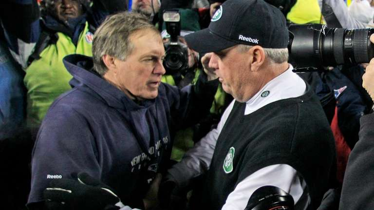 Patriots head coach Bill Belichick, left, congratulates Jets