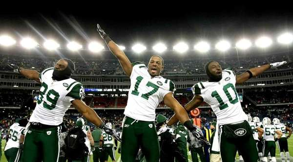 Jets' Jerricho Cotchery, left, Braylon Edwards, and Santonio