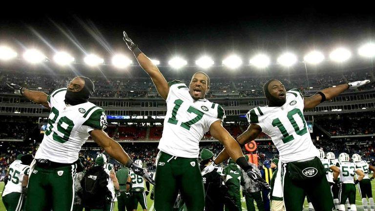 Jets' Jerricho Cotchery, left, Braylon Edwards, and Santonio