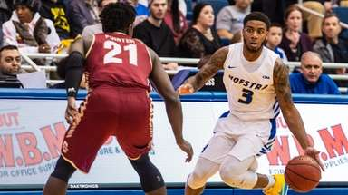Hofstra Pride guard Justin Wright-Foreman dribbles upcourt on