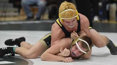 Jeremy Scutellaro of Massapequa, top, battles Matt McCoy
