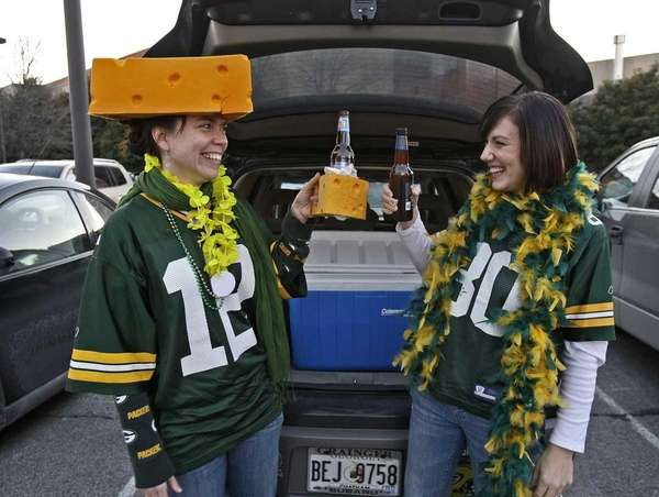 Green Bay Packers fans Sarah Barlow, left, and