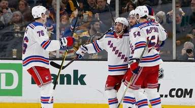 Rangers center Mika Zibanejad, second from right, is