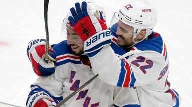 Rangers center Mika Zibanejad is congratulated by teammate