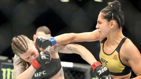Joanne Calderwood, left, fights Ariane Lipski during UFC
