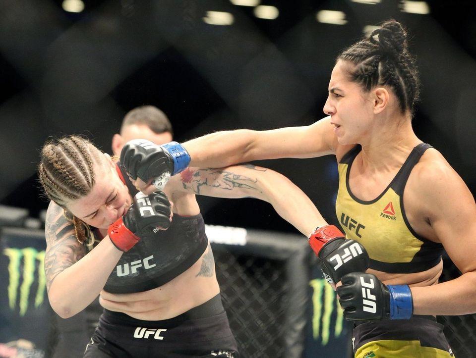 Joanne Calderwood, left, fights Ariane Lipski during UFC