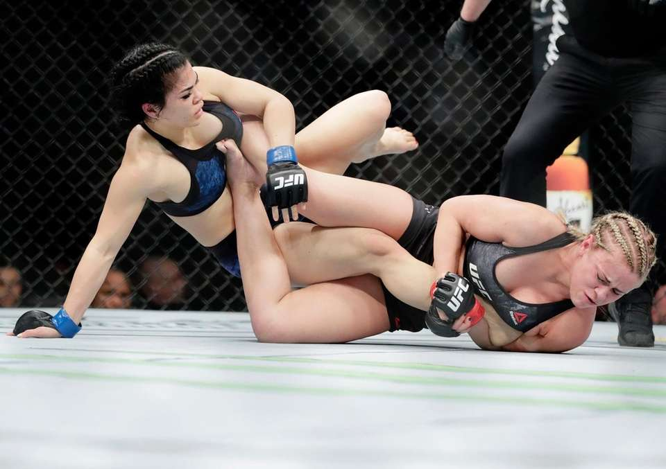 Rachael Ostovich, left, grapples with Paige Vanzant during