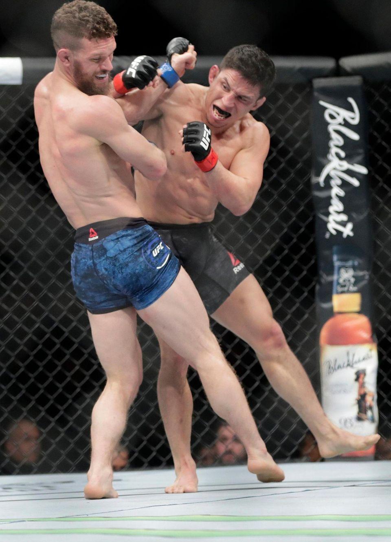 Joseph Benavidez, right, punches Dustin Ortiz during the