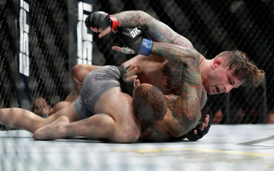 Gregor Gillespie, top, punches Yancy Medeiros during the