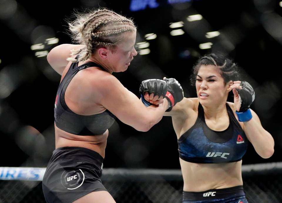 Rachael Ostovich, right, punches Paige VanZant during the