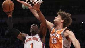 New York Knicks' Amare Stoudemire (1) drives past