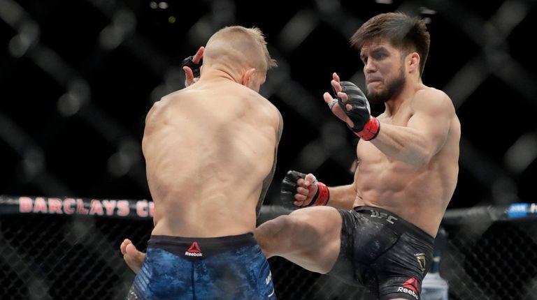 Henry Cejudo, right, kicks TJ Dillashaw during the