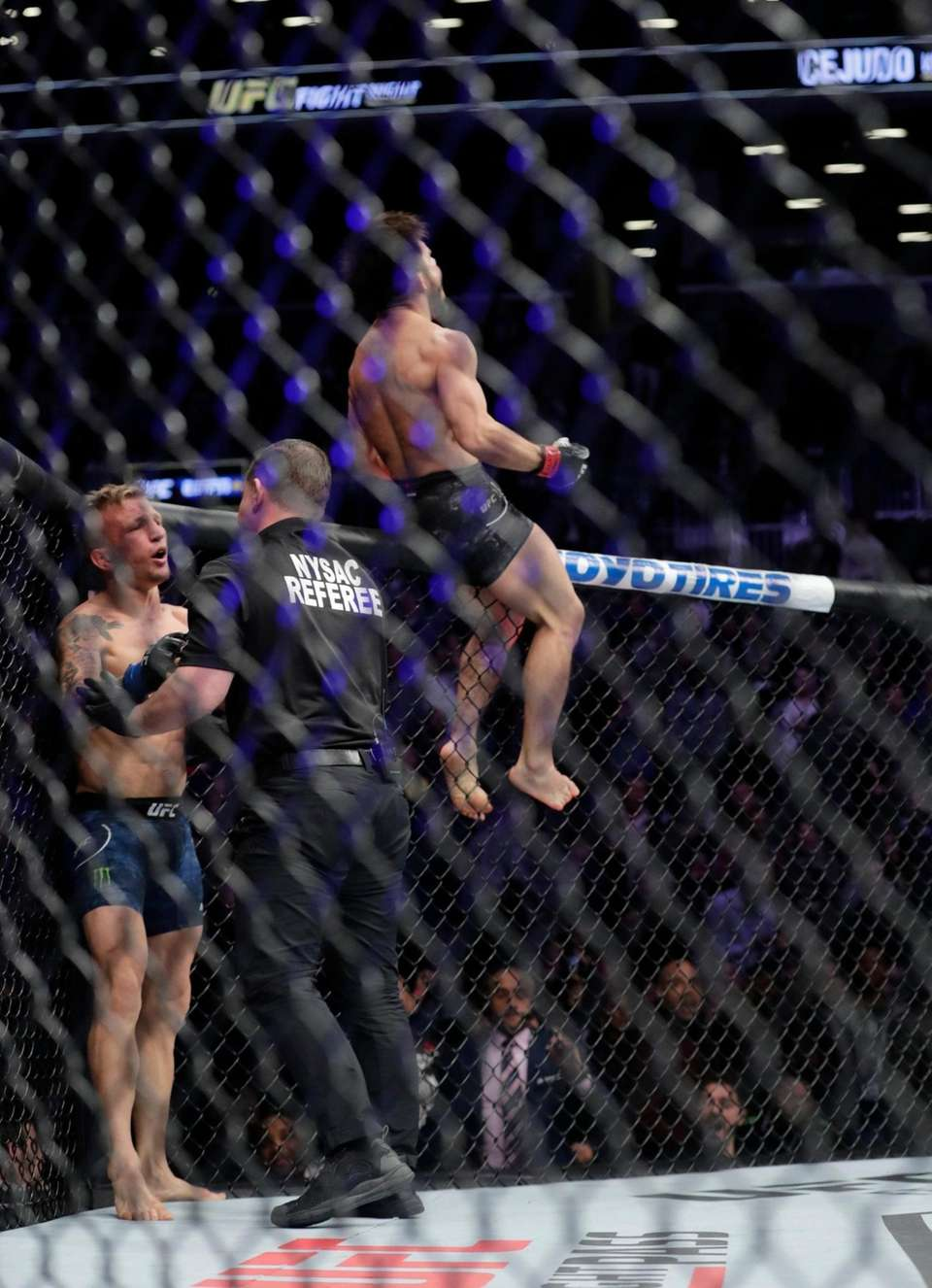 Henry Cejudo, right, celebrates after stopping TJ Dillashaw