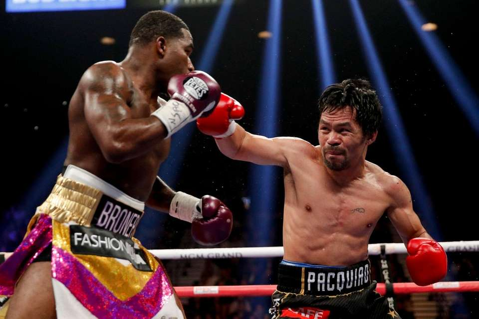 Manny Pacquiao, right, throws a right to Adrien
