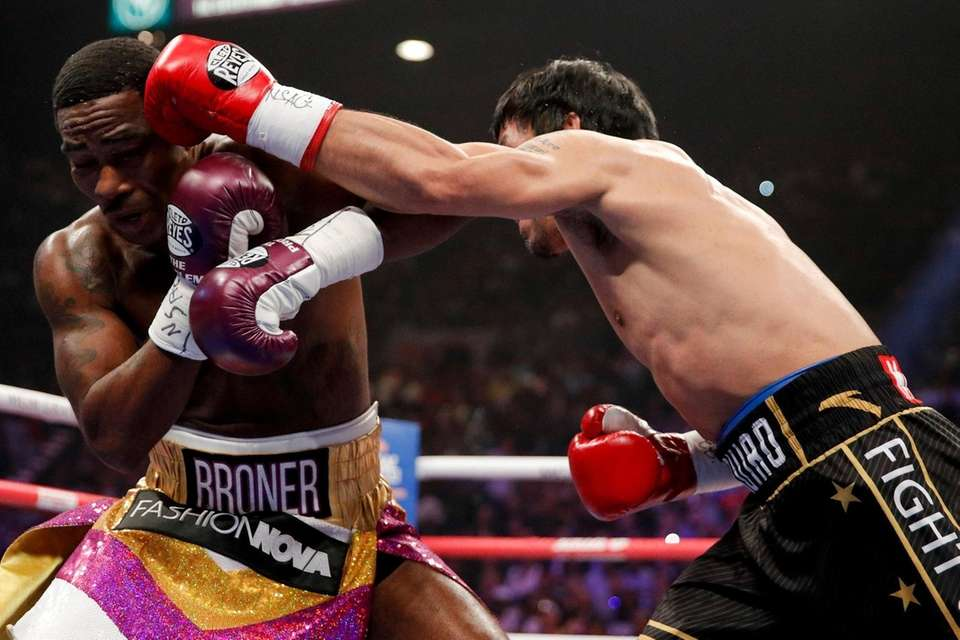Manny Pacquiao, right, throws a left to Adrien