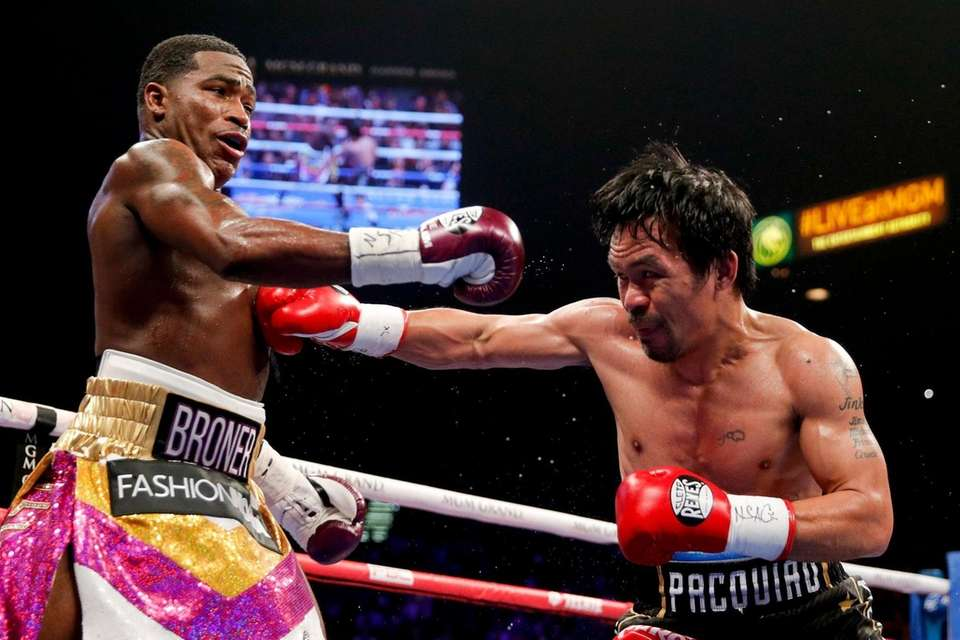 Manny Pacquiao, right, hits Adrien Broner during their