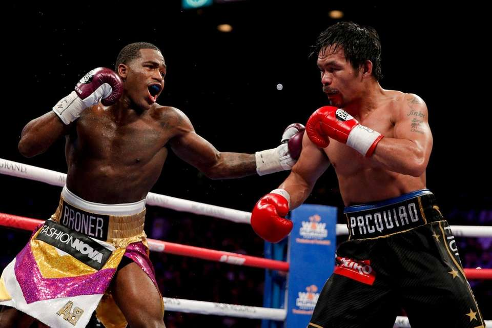 Adrien Broner, left, hits Manny Pacquiao during the