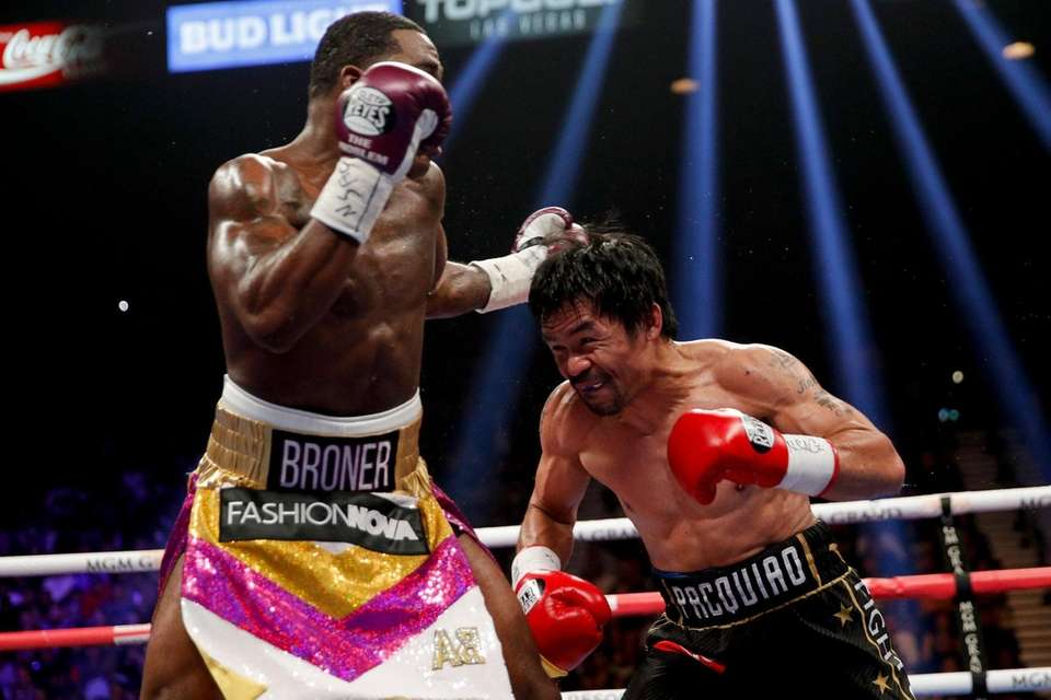Manny Pacquiao, right, fights Adrien Broner in the
