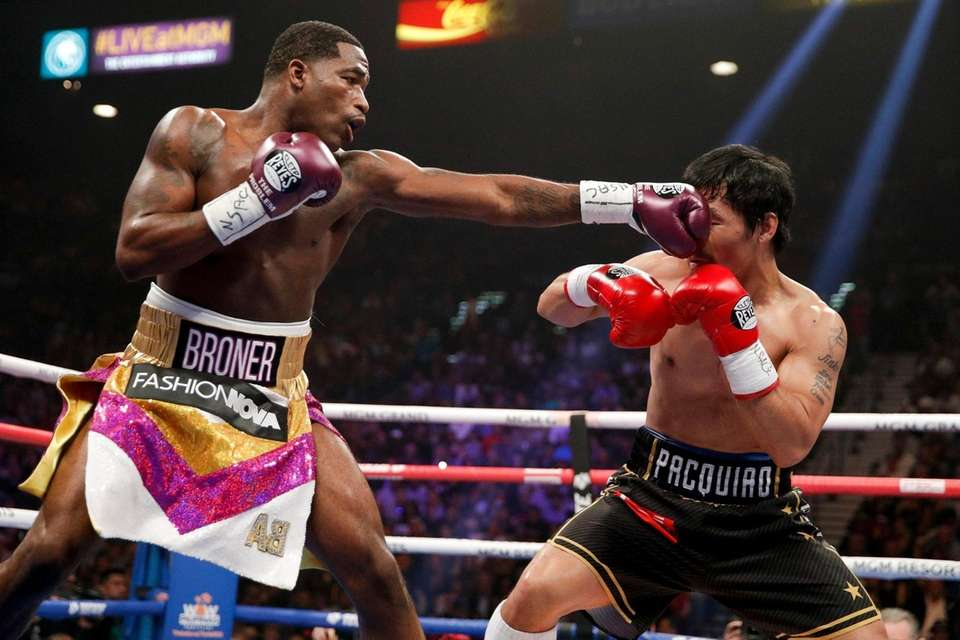 Adrien Broner hits Manny Pacquiao during the WBA