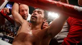 Manny Pacquiao celebrates his win against Adrien Broner