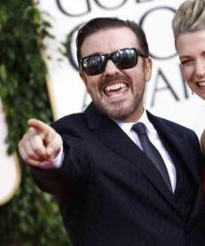 Ricky Gervais and his date arrive at the