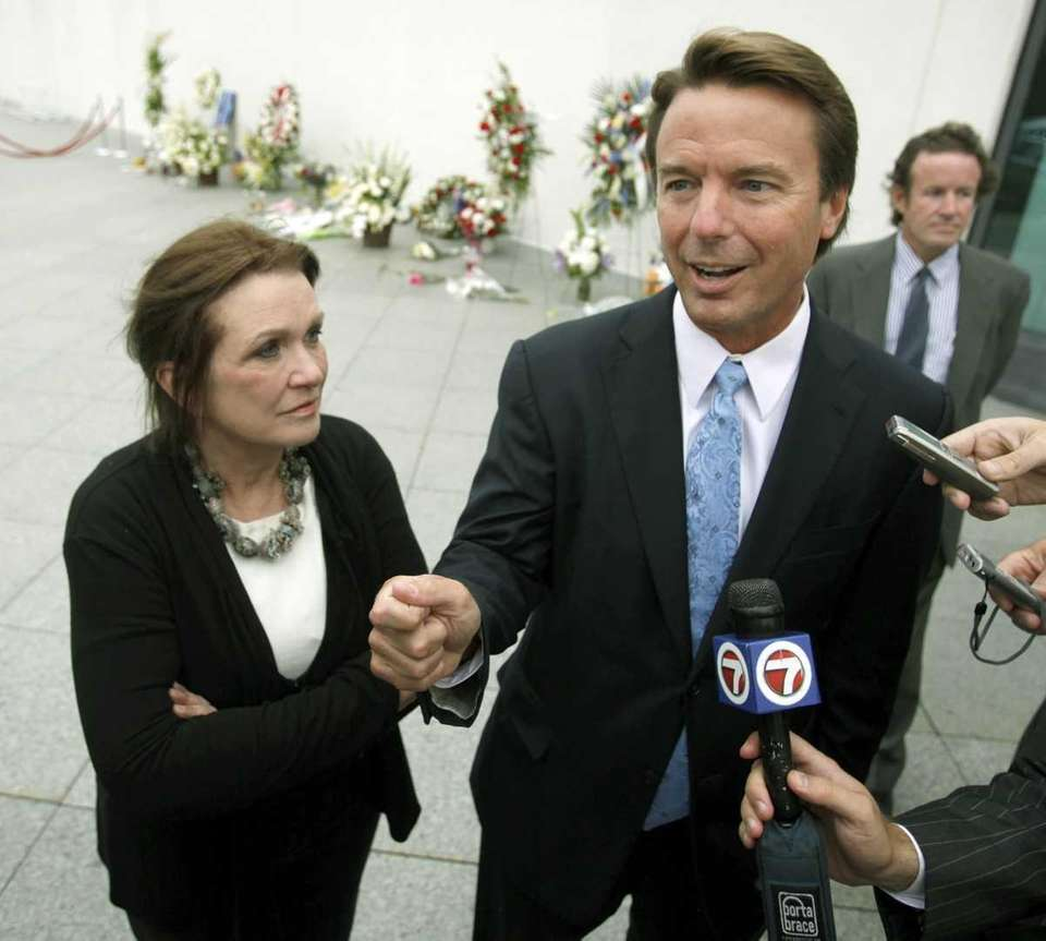 Former Sen. John Edwards, right, arrives with his