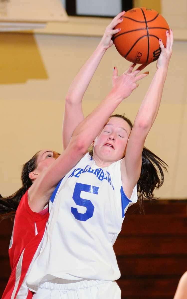 Kellenberg's Katie Flynn grabs a rebound in the