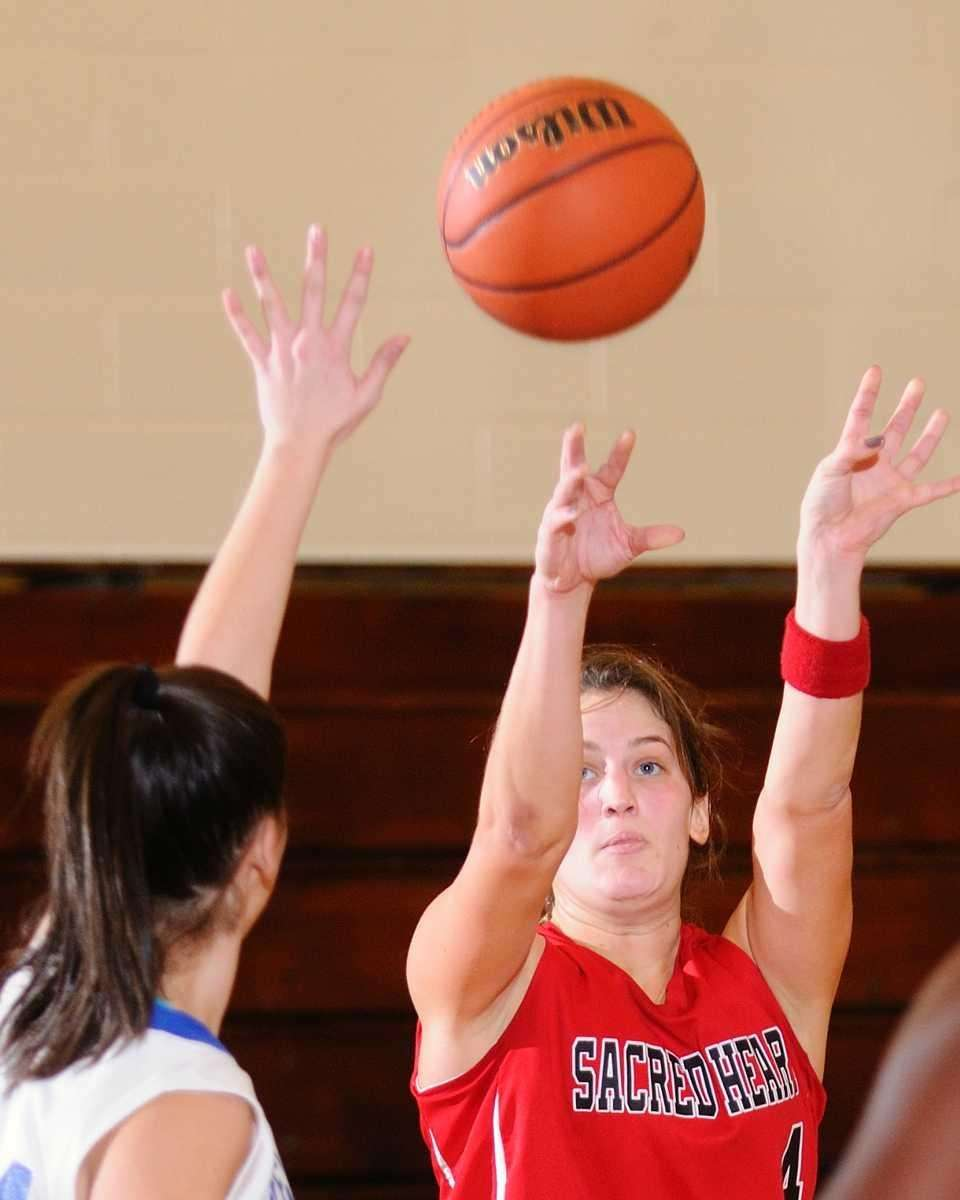 Sacred Heart's Taylor Higgins, right, shoots a jumper