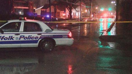 Suffolk County police investigate at the scene where