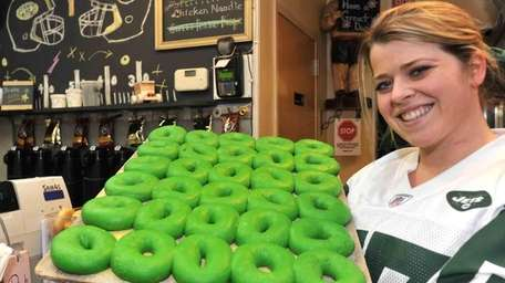 Kaitlyn Clancy of Lynbrook Bagels shows off green-colored