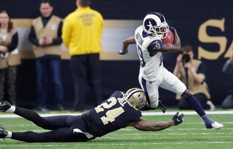 Los Angeles Rams' JoJo Natson tries to get