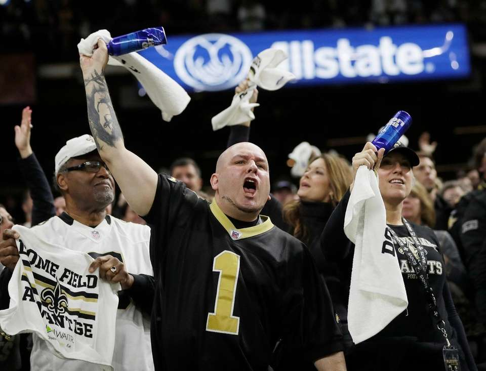 Fans cheer during the first half the NFL