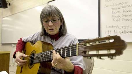 Suzanne Ernst of Huntington performs a song during