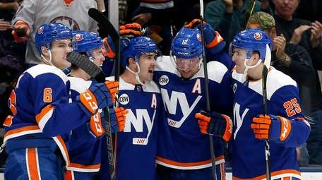 Cal Clutterbuck, No. 15, of the Islanders celebrates