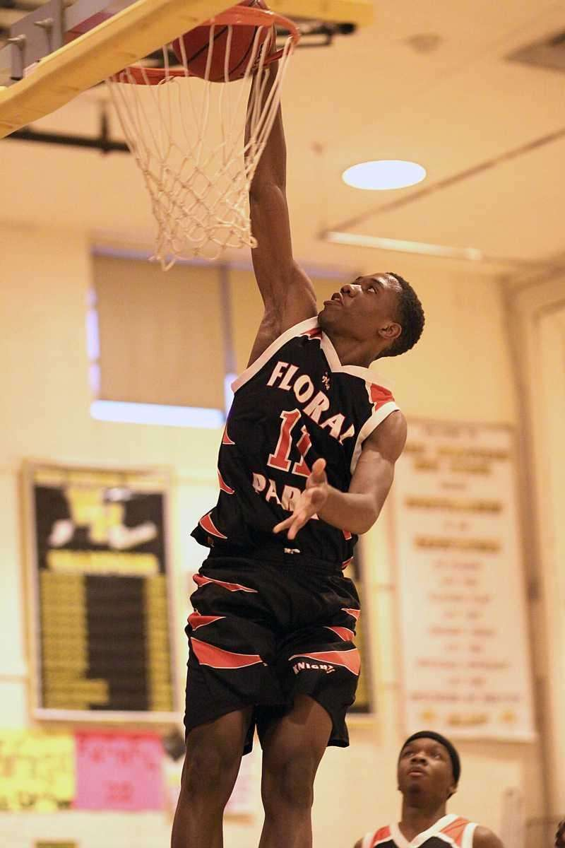 Floral Park's Shamoy McIntosh with the slam dunk