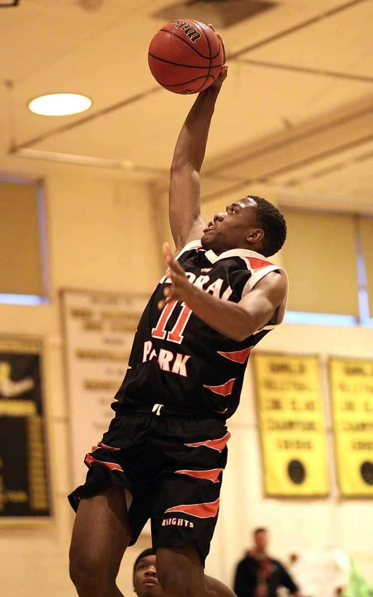 Floral Park's Shamoy McIntosh gets the dunk as