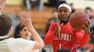 BellportÕs Lorenz Aikens looks for an open teammate