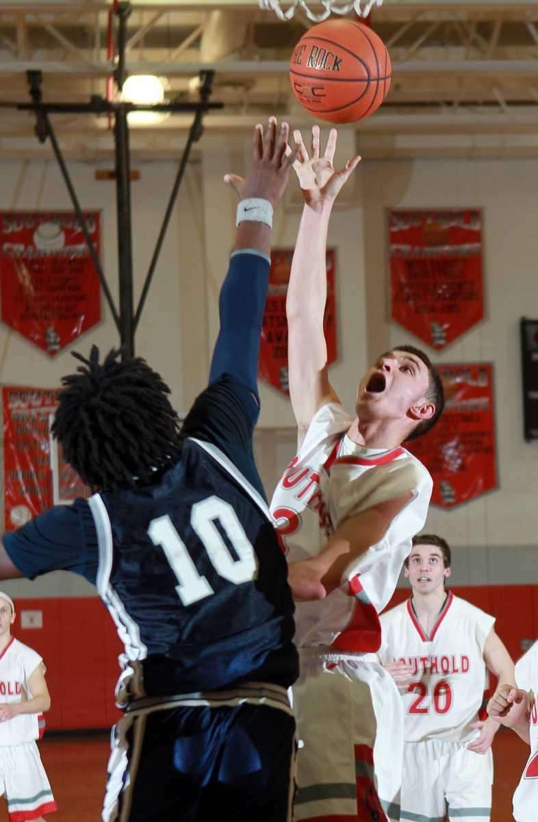 Southold's Winston Wilcneski (3) with the shot over