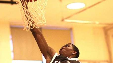 Floral Park's Shamoy McIntosh goes to the hoop