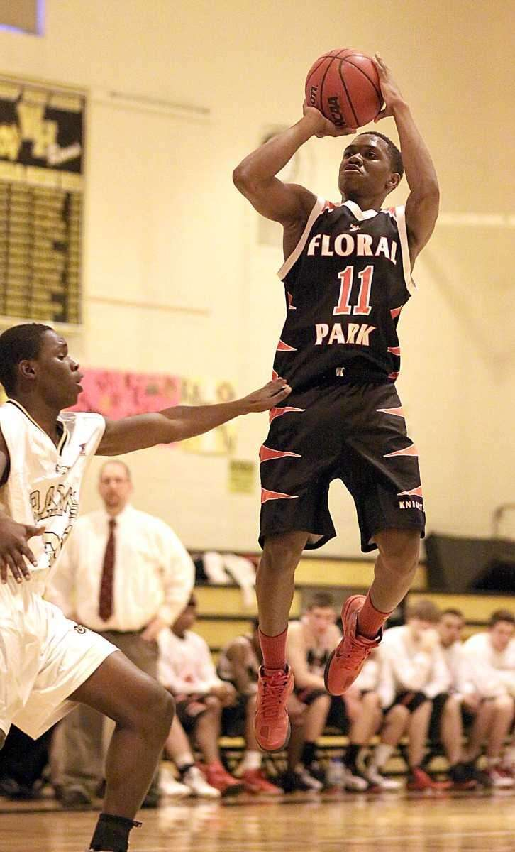 Floral Park's Shamoy McIntosh shoots from outside as