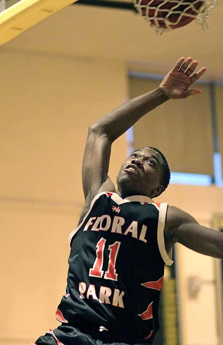 Floral Park's Shamoy McIntosh watches his shot go
