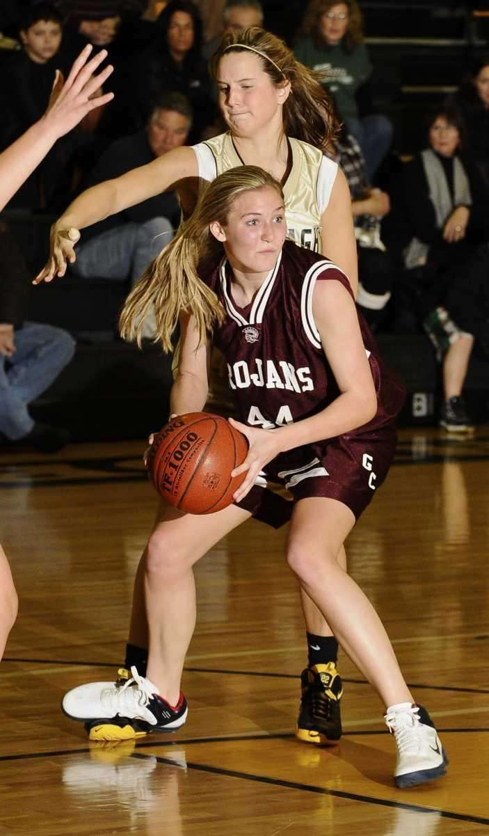 Garden City's Christina Mangels looks to pass guarded